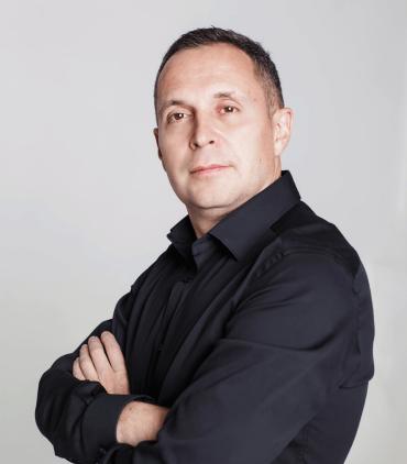 Евгений Марченко, директор компании E. M. FINANCE