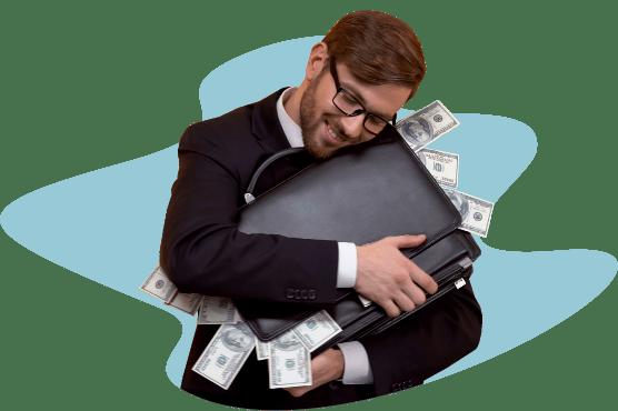 мужчина обнимает портфель с деньгами